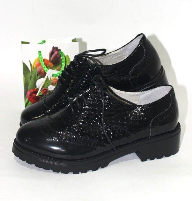 Туфельки на низком каблуке